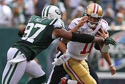 Sept 30, 2012; East Rutherford, NJ, USA; San Francisco 49ers quarterback Alex Smith (11) is sacked by New York Jets outside linebacker Calvin Pace (97) during the first half at MetLIfe Stadium.