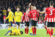 Sheffield United midfielder John Fleck (4) is shown a yellow card by the referee Mike Dean during the Premier League match between Sheffield United and Arsenal at Bramall Lane, Sheffield, England on 21 October 2019.