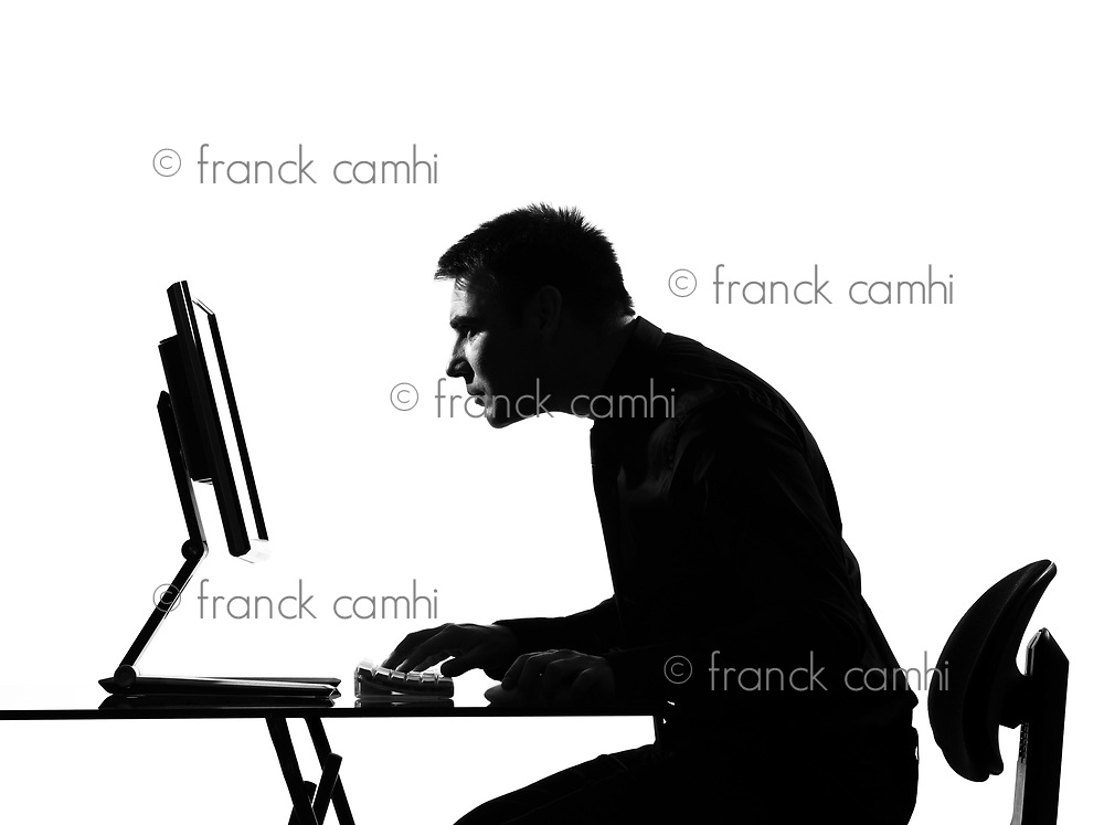 silhouette caucasian business man  computing computing staring at the monitor on studio isolated white backgroun