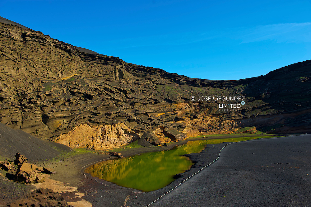 The emerald green waters of the El Golfo crater on Isle de Lanzarote