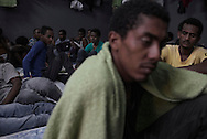Libya, Garabulli: Inside view of a cell where Somali migrants captured at the sea as they were attempting to reach Italy are kept at Alguaiha detention center on May 12, 2015. Alessio Romenzi