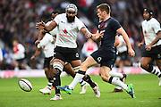 England's Owen Farrell kicks the ball forward during the Autumn International Series match between England and Fiji at Twickenham, Richmond, United Kingdom on 19 November 2016. Photo by Ian  Muir.