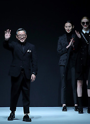 Designer Liu Yong (L) gestures during a fashion show titled Henry Herbert Liu Yong Private Custom Collection at China Fashion Week in Beijing, capital of China, March 31, 2016. EXPA Pictures © 2016, PhotoCredit: EXPA/ Photoshot/ Chen Jianli<br /> <br /> *****ATTENTION - for AUT, SLO, CRO, SRB, BIH, MAZ, SUI only*****