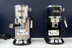 © Licensed to London News Pictures. 07/04/2016. DeLonghi coffee making machines on display at The London Coffee Festival. Now its 4th year, will attract over 35,00 visitors over the four day event. London, UK. Photo credit: Ray Tang/LNP