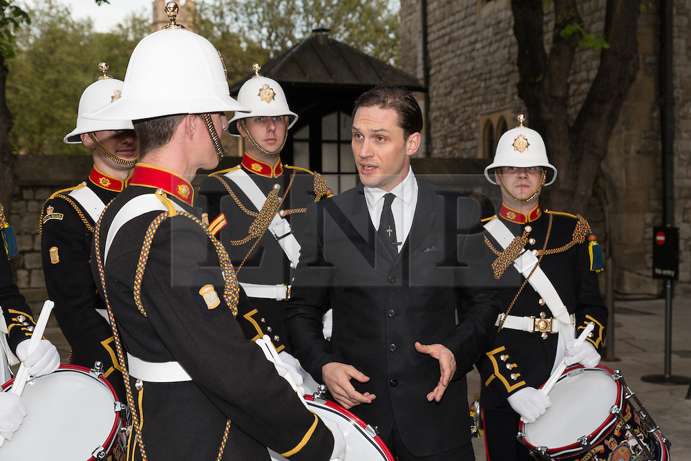 © Licensed to London News Pictures. 30/04/2014. London, UK. British actor, Tom Hardy chats to Royal Marines in the Tower of London on 30th April 2014. The Royal Marines Corps of Drums are attempting to break the World record for the longest continuous drum roll as part of a year of celebrations to mark the 350th anniversary of the Royal Marines and raising money for the Royal Marines Charitable Trust Fund.  The current record stands at 28 hours, 19 minutes and 3 seconds and they hope to extend this to 64 hours. Photo credit : Vickie Flores/LNP