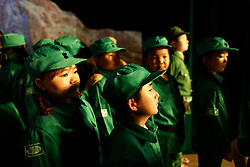 Members of 'Longzaitian' or 'Dragon in the Sky' Shadow Puppet Troupe dressed in Communist Party Red army uniforms wait to perform in a rehearsal for a show titled 'Findling the Anti-Japanese Hero' in Beijing, China, 29 May 2015. The troupe which consists of about 50 members who look like children but are actually dwarfs with an average age of 22 and height of 1.26 metres. Formed in 2008, the troupe started out with less than ten members but gradually grew in fame and stature, drawing many other dwarfs from all parts of China who seek to be accepted in a community of their own. The troupe provides training, food, accommodation and income for the members as well as a sense of belonging and pride in their work preserving the ancient art of shadow puppetry. Dwarfs have traditionally been viewed as disabled people in China and are often discriminated by mainstream society.