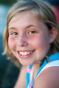 Niece Rachel Stute, 11, enjoys sitting along Lake Mendota near the Memorial Union Terrace at the University of Wisconsin-Madison in Madison, Wis., during sunset on July 2, 2011. Stute was waiting for nightfall and the start of the annual Rhythm and Booms fireworks show across the lake at Warner Park.