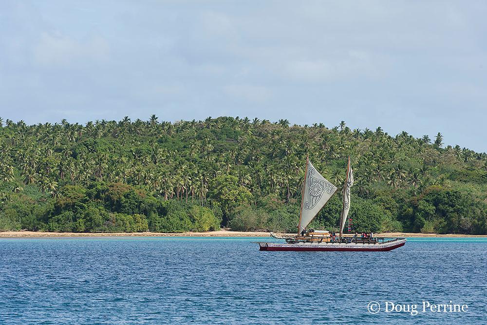 traditional double-hulled Polynesian voyaging canoe or waka, Hine Moana, in Hunga Lagoon, furling sails as it approaches Hunga Village, Hunga Island, Vava'u, Kingdom of Tonga, South Pacific