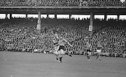 Down player kicks the ball clear while Kerry player tackles him during the All Ireland Senior Gaelic Football Final Kerry v Down in Croke Park on the 22nd September 1968. Down 2-12 Kerry 1-13.