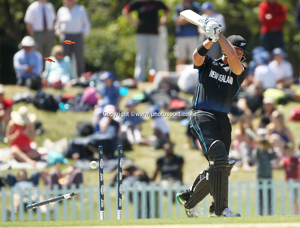 Corey Anderson of New Zealand being bowled during the ICC Cricket World Cup warm up game between New Zealand v South Africa at Hagley Oval, Christchurch. 11 February 2015 Photo: Joseph Johnson / www.photosport.co.nz