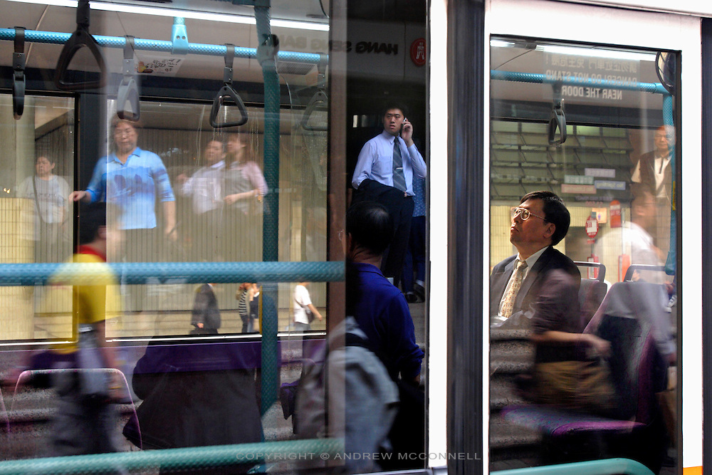 Commuter on bus; downtown Hong Kong, Tuesday, Apr. 19, 2005. The bustling city has a population 7 million..