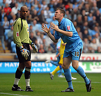 Photo: Ed Godden.<br />Coventry City v Leeds United. Coca Cola Championship. 16/09/2006. Coventry's Kevin Kyle (R)  misses a chance on goal.