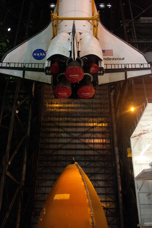 Space shuttle Endevour is lifted inside the Vehicle Assembly Building for mating with the ET and SRB stack.