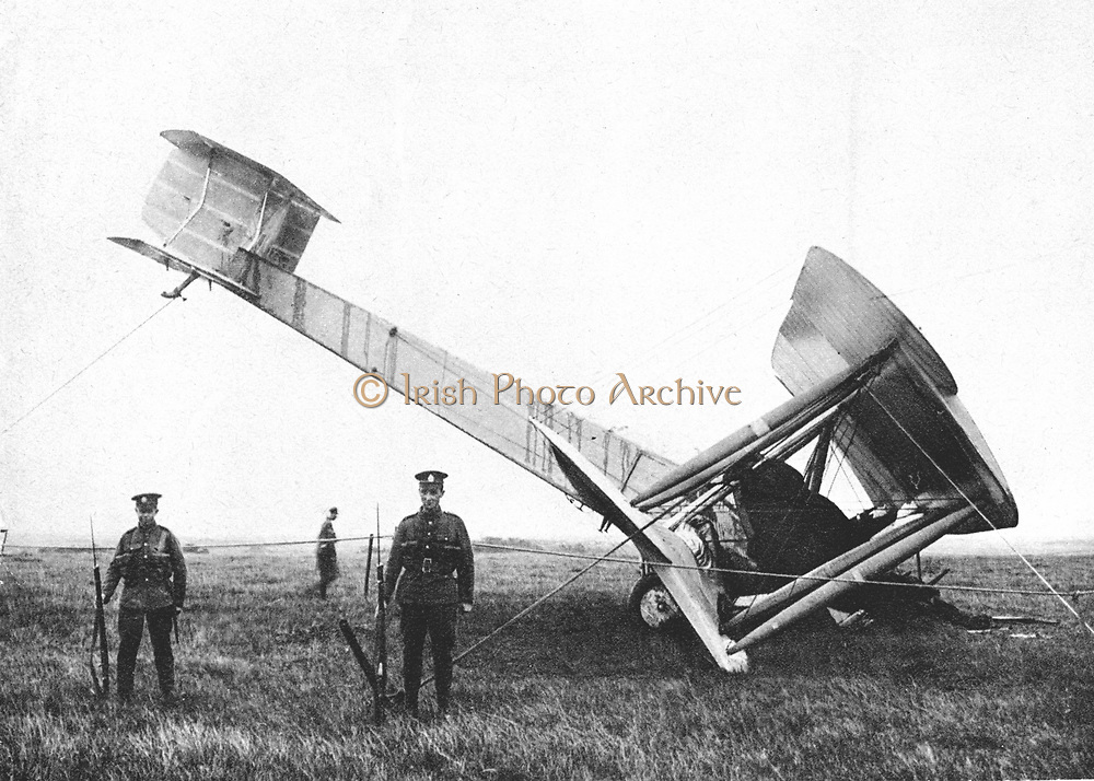 John William Alcock (1892-1919) and Arthur Whitten Brown (1886-1948) British aviators. First men to fly Atlantic non-stop, 14 June 1919. Their Vickers-Vimy-Rolls bomber in the bog where they landed being guarded by British troops.