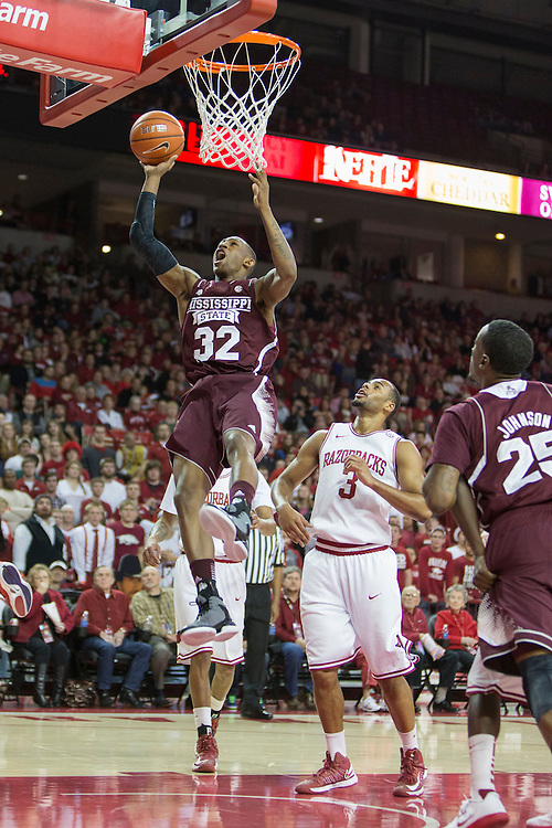 FAYETTEVILLE, AR - JANUARY 23:  Craig Sword #32 of the Mississippi State Bulldogs goes up for a lay up against the Arkansas Razorbacks at Bud Walton Arena on January 23, 2013 in Fayetteville, Arkansas. The Razorbacks defeated the Bulldogs 96-70.  (Photo by Wesley Hitt/Getty Images) *** Local Caption *** Craig Sword