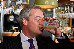 © London News Pictures. 03/05/2013. London, UK. UKIP party leader NIGEL FARAGE drinks in Marquis Of Granby pub surrounded by media following his party's success in the council elections across England.Photo credit : Stephen Simpson/LNP