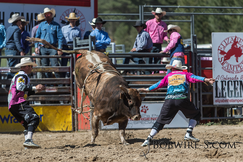 Bullfighters Cade Burns (right) and Nate Jestes protect Adam Cook from Salt River Rodeo's 8B Broken Halos in the first performance of the Elizabeth Stampede on Saturday, June 2, 2018.