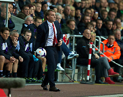 6.09.2013, Liberty Stadion, Swansea, ENG, Premier League, Swansea City vs FC Liverpool, 4. Runde, im Bild Liverpool's manager Brendan Rodgers acts a s a ball boy during the English Premier League 4th round match between Swansea City AFC and Liverpool FC at the Liberty Stadium, Swansea, Great Britain on 2013/09/16. EXPA Pictures © 2013, PhotoCredit: EXPA/ Propagandaphoto/ David Rawcliffe<br /> <br /> ***** ATTENTION - OUT OF ENG, GBR, UK *****