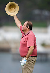 February 12, 2010; Pebble Beach, CA, USA; ESPN commentator Chris Berman salutes teammate J.J. Henry (not pictured) on the sixth hole during the second round of the AT&T Pebble Beach Pro-Am at Pebble Beach Golf Links.