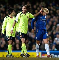 Photo: Richard Lane.<br />Chelsea v Barcelona. UEFA Champions League. 22/02/2006.<br />Barcelona's Thiago Motta consoles Chelsea's Eidur Gudjohnsen (R).