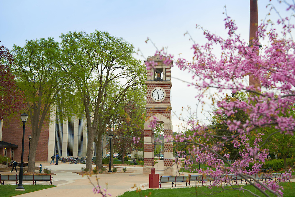 Buildings; Cowley; Clock Hoeschler Tower; Location; Outside; Objects; Flowers; People; Student Students; Spring; April; Time/Weather; day; UWL UW-L UW-La Crosse University of Wisconsin-La Crosse