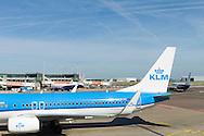 Nederland, Amsterdam, 20160609.<br /> Vliegveld Schiphol nabij Amsterdam<br /> Vliegtuig van KLM (opschrift KLM op de achtervleugel)<br /> <br /> Netherlands, Amsterdam<br /> Airport Amsterdam