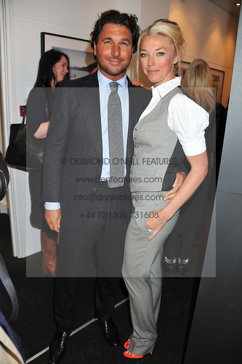 TAMARA BECKWITH and GIORGIO VERONI at a private view of the late Patrick Lichfield: Nudes at The Little Black gallery, 13A Park Walk, London SW10 on 26th April 2012.
