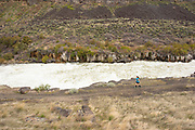 Female runner at Auger Falls trails in the Snake River canyon of Twin Falls, Idaho. MR