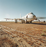 In mid-day heat of the arid Sonoran desert sit the remains of a Boeing 747 airliner at the storage facility at Mojave, California. Here, the fate of the world's retired civil airliners is decided by age or a cooling economy and are either cannibalised for still-working parts or recycled for scrap, their aluminium fuselages worth more than their sum total. After a lifetime of safe commercial flight, wings are clipped and cockpits sliced apart by huge guillotines, cutting through their once-magnificant engineering. Picture from the 'Plane Pictures' project, a celebration of aviation aesthetics and flying culture, 100 years after the Wright brothers first 12 seconds/120 feet powered flight at Kitty Hawk,1903. .