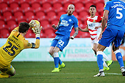 Peterborough Utd goalkeeper Conor O'Malley (25) saves this shot from Doncaster Rovers forward Tyler Smith (18) during the EFL Sky Bet League 1 match between Doncaster Rovers and Peterborough United at the Keepmoat Stadium, Doncaster, England on 9 February 2019.