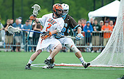 2011/05/22 - RIT's Iric Bressler (in white) drives to the goal in the first quarter of RIT's National Semifinal game against Tufts University. Tufts defeated RIT 16-12 to advance to the National Championship against Salisbury.
