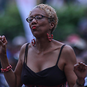 A spectator dances to the music during the 27th DuPont Clifford Brown Jazz Festival Saturday, June 20, 2015, at Rodney Square in Wilmington, Delaware.
