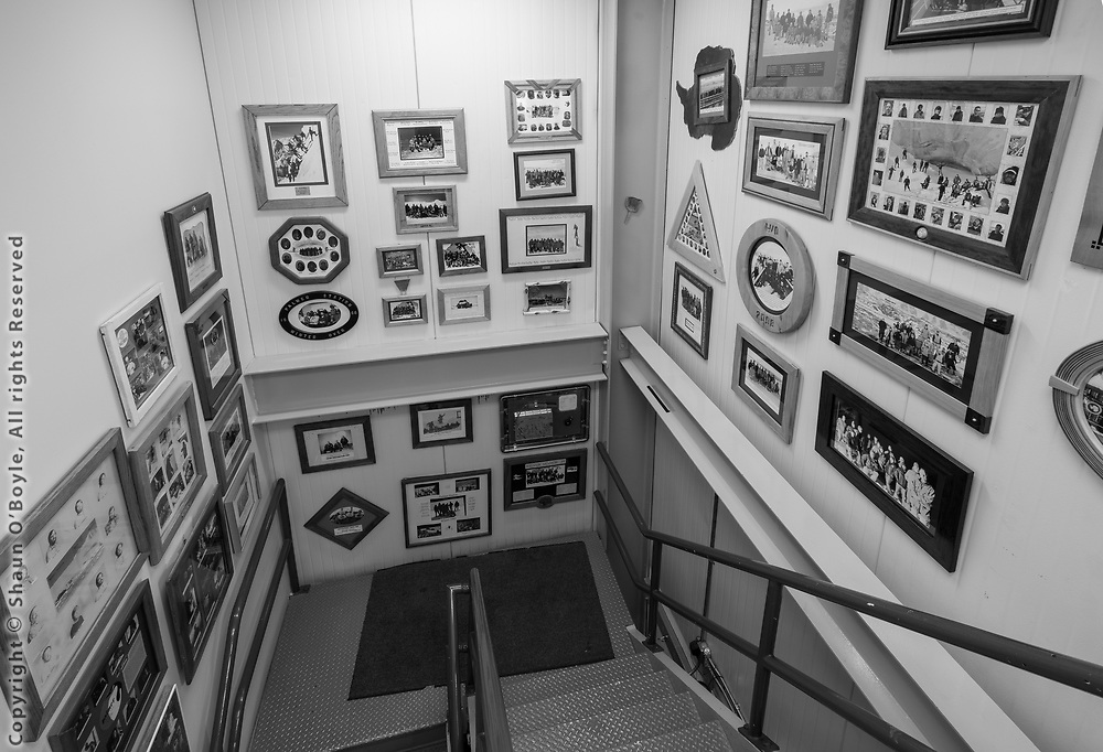 GWR stairway with photos of every winter over crew