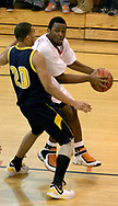 The Beavers Justin Tillman works around the Wildcats Vince Martin (20) as the Beavercreek Beavers host the Springfield South High School Wildcats Friday night, February 2, 2007.