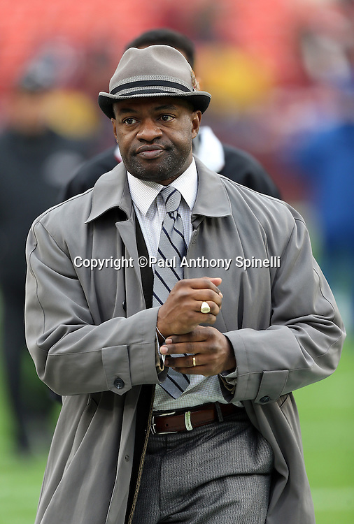 Executive director of the NFL Players Association DeMaurice Smith walks the sideline during the Washington Redskins NFL week 14 football game against the Baltimore Ravens on Sunday, Dec. 9, 2012 in Landover, Md. The Redskins won the game in overtime 31-28. ©Paul Anthony Spinelli