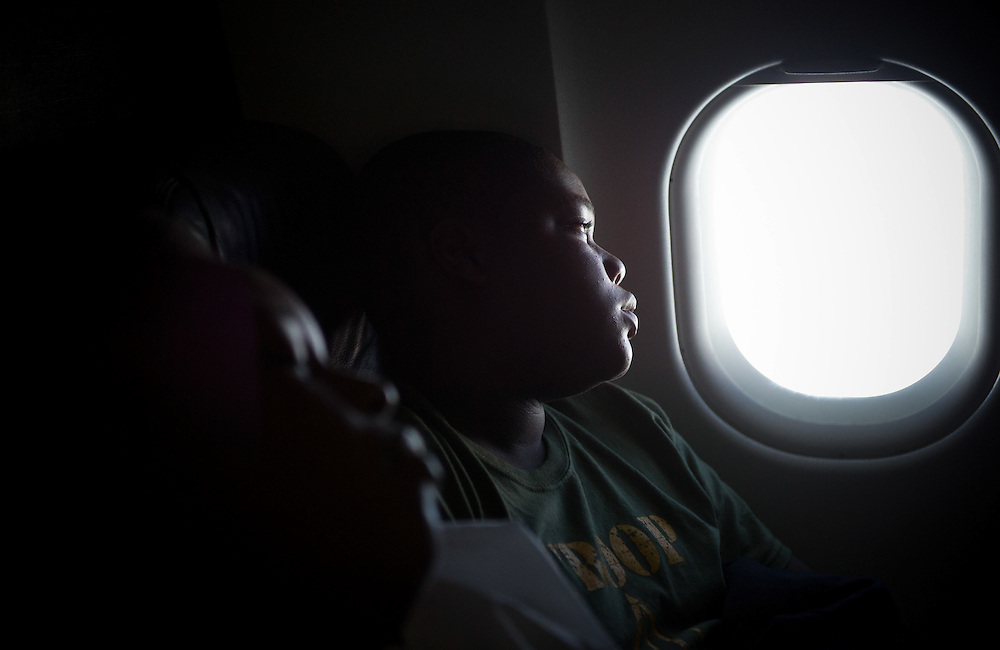 "Xavier Mascareñas/Treasure Coast Newspapers; Calvin Minion with Boy Scout Troop 772 looks out of his window while on a plane bound for Washington D.C. on July 22, 2014. None of the boys in Troop 772, Fort Pierce's ""Scoutreach"" group, had flown before the trip."