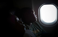 """Xavier Mascareñas/Treasure Coast Newspapers; Calvin Minion with Boy Scout Troop 772 looks out of his window while on a plane bound for Washington D.C. on July 22, 2014. None of the boys in Troop 772, Fort Pierce's """"Scoutreach"""" group, had flown before the trip."""