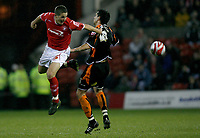 Photo: Richard Lane/Richard Lane Photography. Nottingham Forest v Blackpool. Coca Cola Championship. 13/12/2008. Chris Cohen (L) nods the ball past Joe Martin (R)