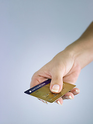 Dec. 14, 2012 - Person holding credit card (Credit Image: © Image Source/ZUMAPRESS.com)