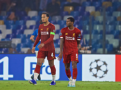 NAPLES, ITALY - Tuesday, September 17, 2019: Liverpool's Virgil van Dijk (L) looks dejected after his mistake led to SSC Napoli's second goal during the UEFA Champions League Group E match between SSC Napoli and Liverpool FC at the Studio San Paolo. Napoli won 2-0. (Pic by David Rawcliffe/Propaganda)