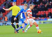 Andy Cannon, Craig Alcocl during the Sky Bet League 1 match between Doncaster Rovers and Rochdale at the Keepmoat Stadium, Doncaster, England on 21 November 2015. Photo by Daniel Youngs.