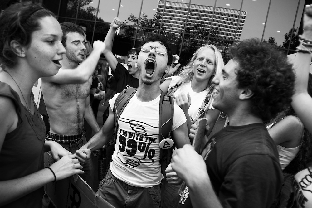 Occupy Los Angeles protesters rejoice after Los Angeles Police Dept officers left without arresting anyone for blocking the entrance to Bank of America.