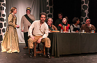 Cordelia Penny, Lady Macbeth stands with Brendan Berube, Macbeth as he sees the ghost of Banquo (Ray Feola) sitting at his place at the table during dress rehearsal for Macbeth with the Streetcar Company Theater at Laconia High School Wednesday evening.  (Karen Bobotas/for the Laconia Daily Sun)