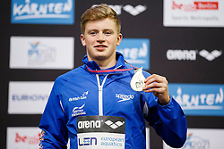 Adam Peaty of Great Britain collects his Gold medal on the podium for the Mens 100m Breaststroke Final - Photo mandatory by-line: Rogan Thomson/JMP - 07966 386802 - 19/08/2014 - SPORT - SWIMMING - Berlin, Germany - Velodrom im Europa-Sportpark - 32nd LEN European Swimming Championships 2014 - Day 7.