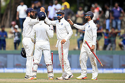 August 6, 2017 - Colombo, Sri Lanka - Indian captain Virat Kohli (2R) walks off with a stump in his hand after India defeated Sri Lanka by an innings and 53 runs during the 4th Day's play in the 2nd Test match between Sri Lanka and India at the SSC international cricket stadium at the capital city of Colombo, Sri Lanka on Sunday 6 August 2017. (Credit Image: © Tharaka Basnayaka/NurPhoto via ZUMA Press)