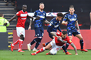 Tyler Roberts (11) of Leeds United fouls Marlon Pack (21) of Bristol City during the EFL Sky Bet Championship match between Bristol City and Leeds United at Ashton Gate, Bristol, England on 9 March 2019.