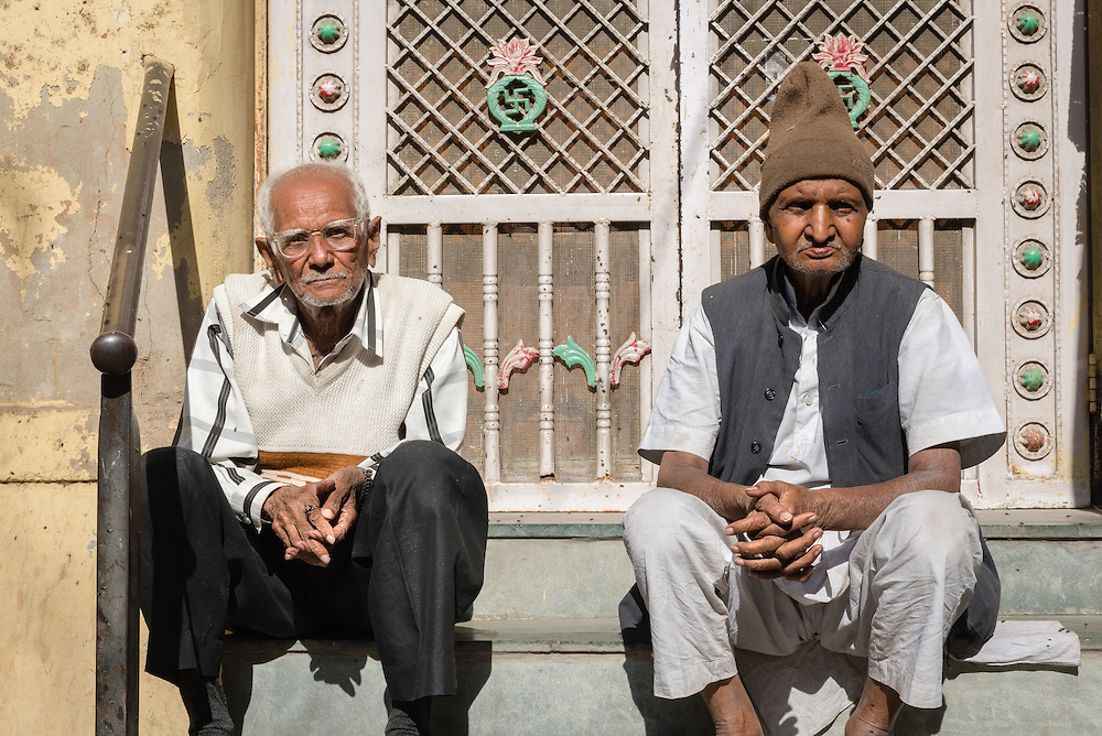 Two men sitting on step in old town Jodhpur