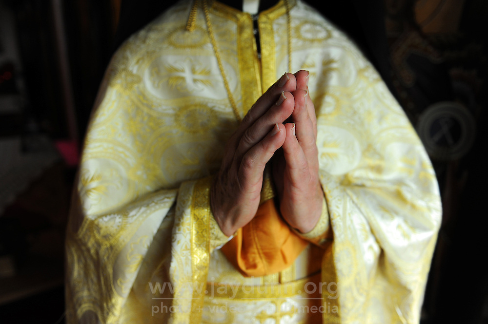 Father Mark Vinas, 84, holds his hands in prayer at the St. John the Baptist Greek Orthodox Church in Salinas.