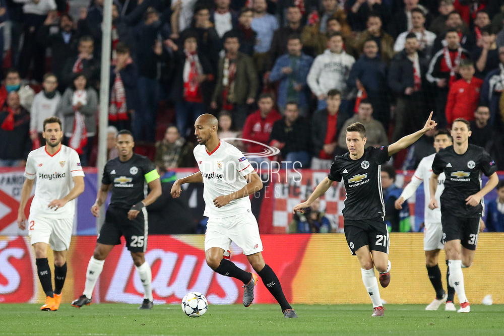 Sevilla midfielder Steven N'Zonzi (15) on the ball with Manchester United Midfielder Ander Herrera giving instructions during the Champions League match between Sevilla and Manchester United at the Ramon Sanchez Pizjuan Stadium, Seville, Spain on 21 February 2018. Picture by Phil Duncan.