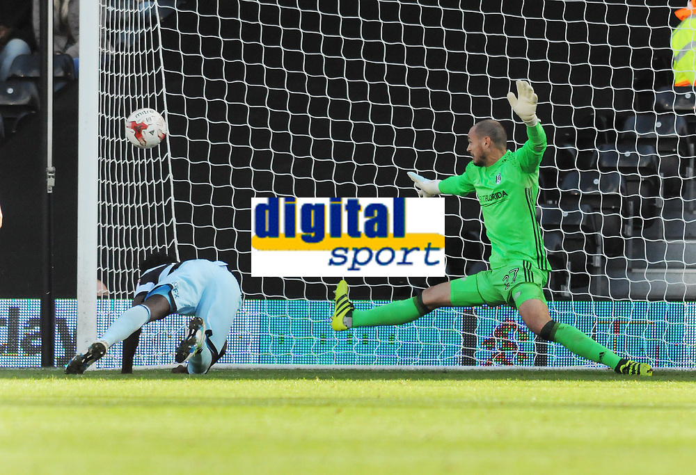 Football - 2016 /2017 Championship - Fulham vs Queens Park Rangers<br /> <br />  Idrissa Sylla of QPR scores the winning goal with a diving header past David Button at Craven Cottage<br /> <br /> Credit : Colorsport / Andrew Cowie